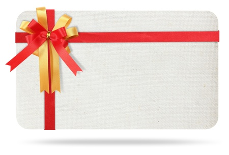 gift tag: Blank gift card tied with a bow of red ribbon. Isolated on white, with save paths for design work