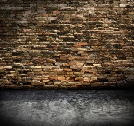 ancient brick wall: old grunge interior with brick wall