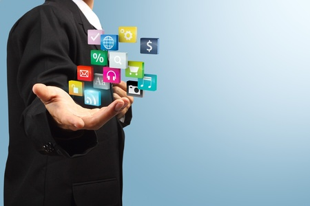 Cloud of colorful application icons in the hands of businessmen   photo