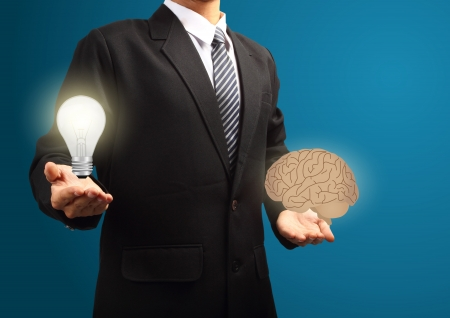 Light bulb and brain in the hands of businessmen  photo