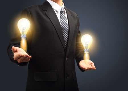 Holding light bulb power of thinking and successful creative idea Stock Photo - 19957788
