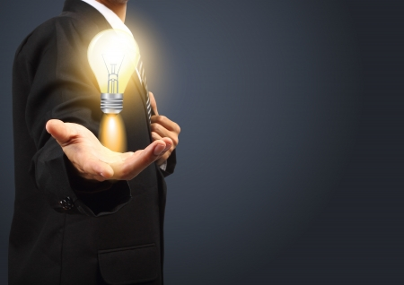 best idea: Holding light bulb power of thinking and successful creative idea
