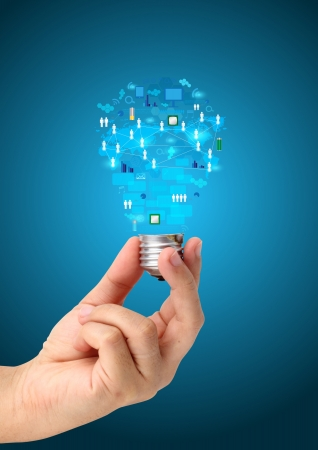 Creative light bulb in hand with technology business network process diagram concept idea photo