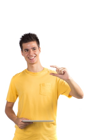 yellow shirt: Young man using a tablet computer PC, isolated on white background