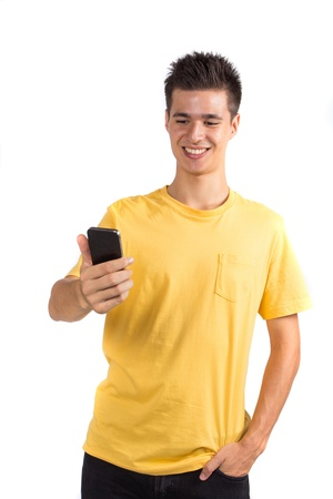 Young man using a mobile phone, isolated on white background photo
