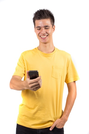 holding cell: Young man using a mobile phone, isolated on white background Stock Photo