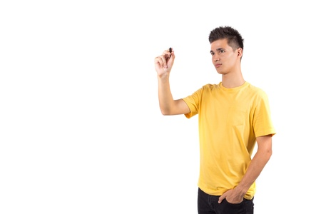 yellow shirt: Young man writing with marker isolated on white background