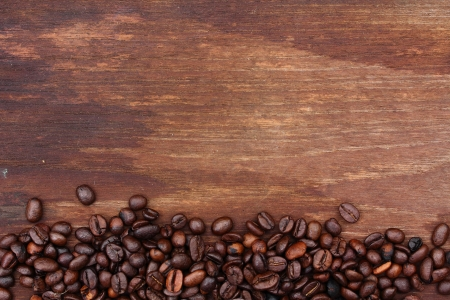 Fresh coffee beans on wood background, Macro close-up for design work
