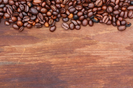 best coffee: Fresh coffee beans on wood background, Macro close-up for design work