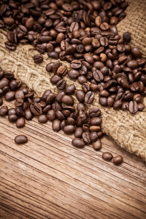 Coffee beans over wood background, Macro close-up for design work   photo