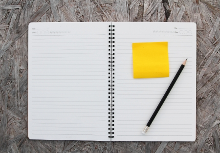 Notebook paper on wood background   photo