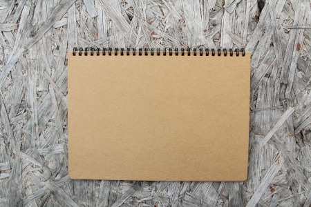 sketchbook: Recycled paper notebook front cover on wood background