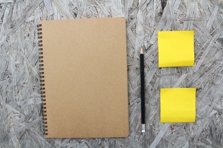 Recycled paper notebook front cover on wood background Stock Photo - 22474673