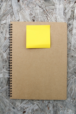 Recycled paper notebook front cover on wood background Stock Photo - 22474674