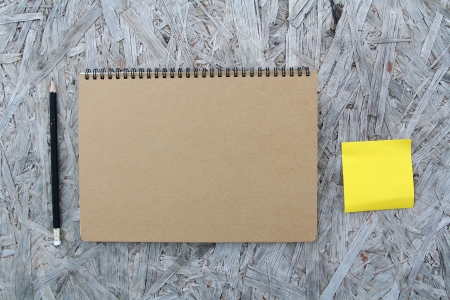 Recycled paper notebook front cover on wood background   Stock Photo - 22474686