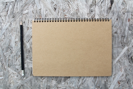 Recycled paper notebook front cover on wood background Stock Photo - 22474687