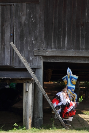 People dress in spirit and wear a mask, at Nakhonratchasima city in Thailand photo