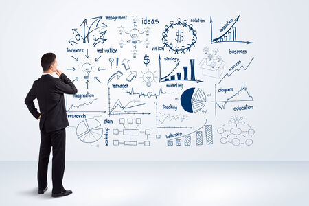 Businessman looking to the future creative drawing charts and graphs business success strategy plan idea