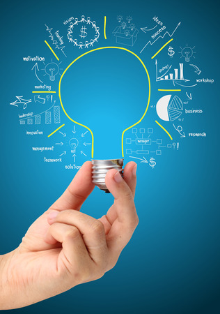 Creative light bulb idea with drawing business success strategy plan concept, Light bulb in hand businessman