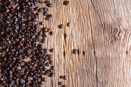 best coffee: Coffee beans on wood background Stock Photo