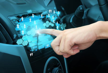 conection: pressing on a touch screen interface navigation system in interior of modern car