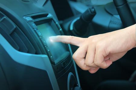 transport interior: Driver entering an address into the navigation system
