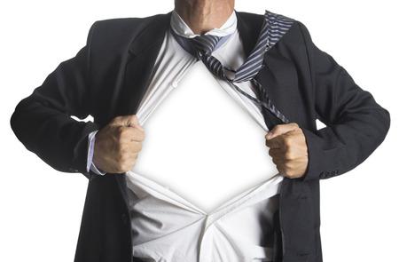 彼のスーツは、白い背景で隔離の下にスーパー ヒーローのスーツを示す実業家