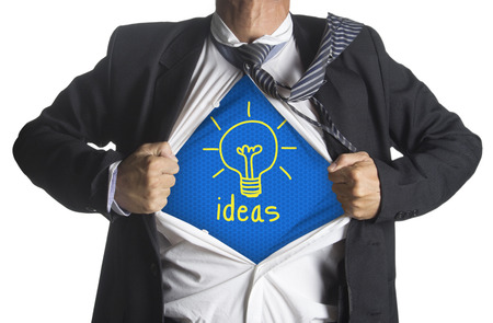 t bulb: Businessman showing a superhero suit underneath idea light bulb symbol, isolated on white background Stock Photo