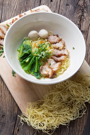 vietnamese food: Noodles bowl on wooden background