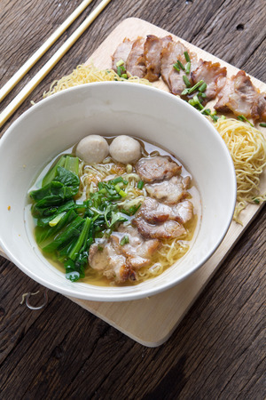 chinese noodle: Noodles bowl on wooden background