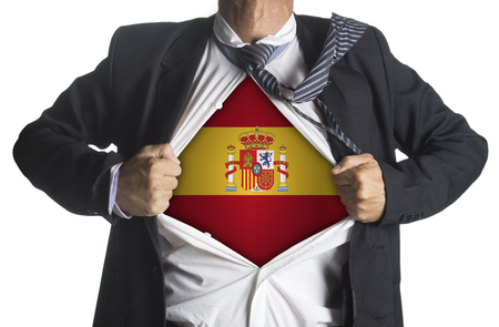 Flag of Spain with coat of arms and businessman showing a superhero suit underneath his suit, isolated on white background photo