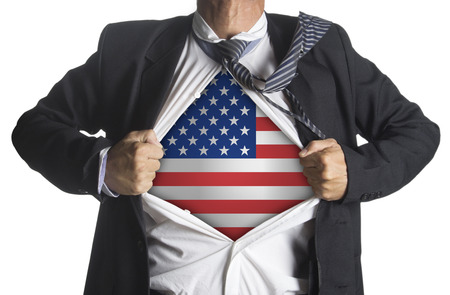 American flag with businessman showing a superhero suit underneath his suit, isolated on white background photo
