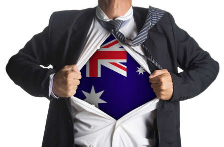 national hero: Australian flag with businessman showing a superhero suit underneath his suit, isolated on white background
