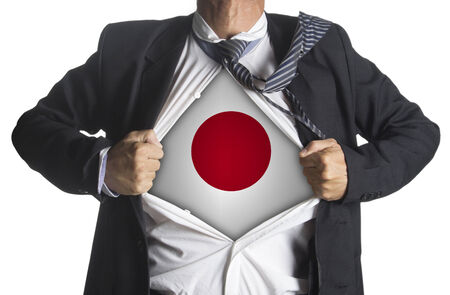 Japan Flag with businessman showing a superhero suit underneath his suit, isolated on white background photo