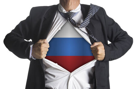 Russia Flag with businessman showing a superhero suit underneath his suit, isolated on white background photo