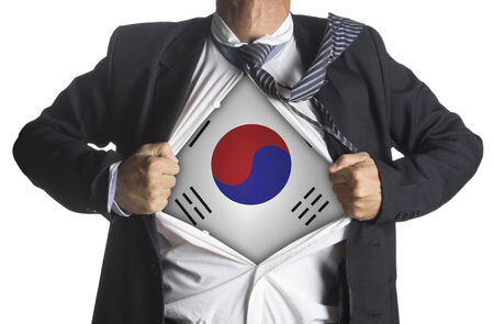 South Korea Flag with businessman showing a superhero suit underneath his suit, isolated on white background photo