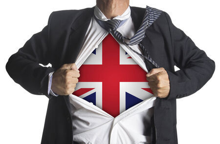 United Kingdom Flag with businessman showing a superhero suit underneath his suit, isolated on white background photo