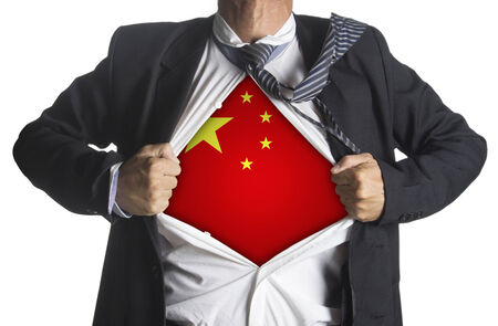 national hero: China flag with businessman showing a superhero suit underneath his suit, isolated on white background