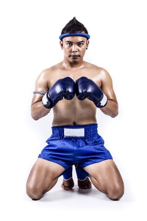 Thai boxer with thai boxing action, isolated on white background Stock Photo