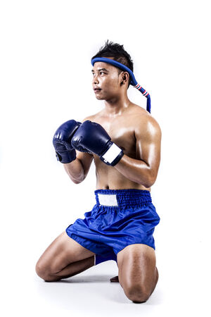 ayutthaya: Thai boxer with thai boxing action, isolated on white background Stock Photo