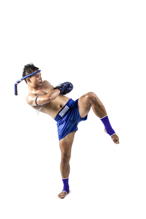 thai dancing: Thai boxer with thai boxing action, isolated on white background Stock Photo
