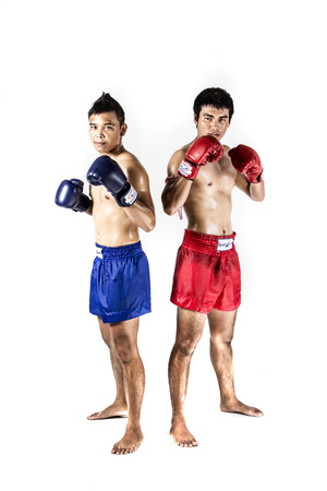 ayutthaya: two asian men exercising thai boxing in silhouette studio on white background Stock Photo
