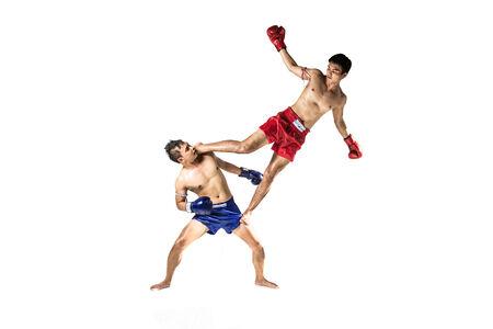 thai arts: two asian men exercising thai boxing in silhouette studio on white background Stock Photo