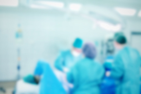 Blurred background with team surgeon at work in operating room