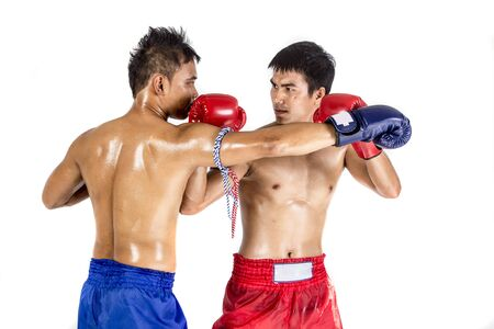 red gloves: Two thai boxers exercising traditional martial art, Isolated on white background