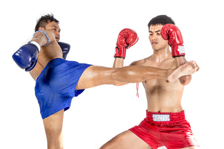 kick boxer: Two thai boxers exercising traditional martial art, Isolated on white background