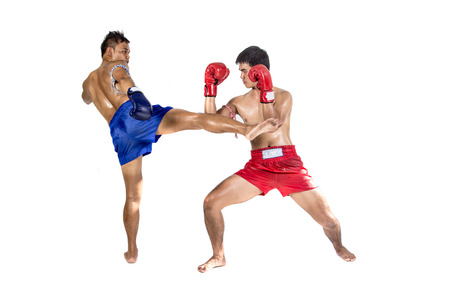 thai arts: Two thai boxers exercising traditional martial art, Isolated on white background
