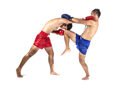 Two thai boxers exercising traditional martial art, Isolated on white background