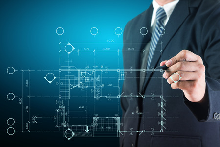 Architect drawing on print construction project design photo