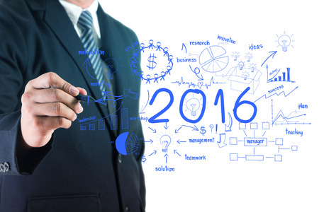 new solution: Business 2016 success concept, With businessman creative drawing chart and graphs strategy plan idea on whiteboard screen Stock Photo